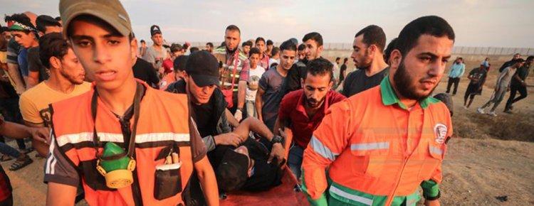 İsrail askerleri Gazze sınırında yaylım ateş açtı: 77 Filistinliyi yaraladı