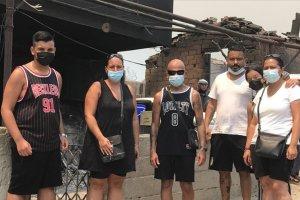 Almanya'dan tatile Manavgat'a giden aile, evleri yananların yardımına koştu
