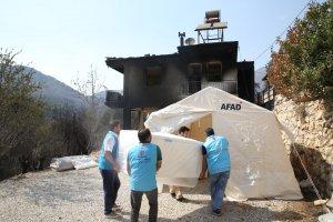 TDV, Manavgat'ta evleri yanan ailelere beyaz eşya yardımında bulundu